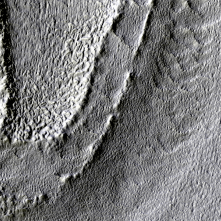 Moraine-like ridges bounding the tongue of a glacial-like form. Subset of PSP_002320_1415.